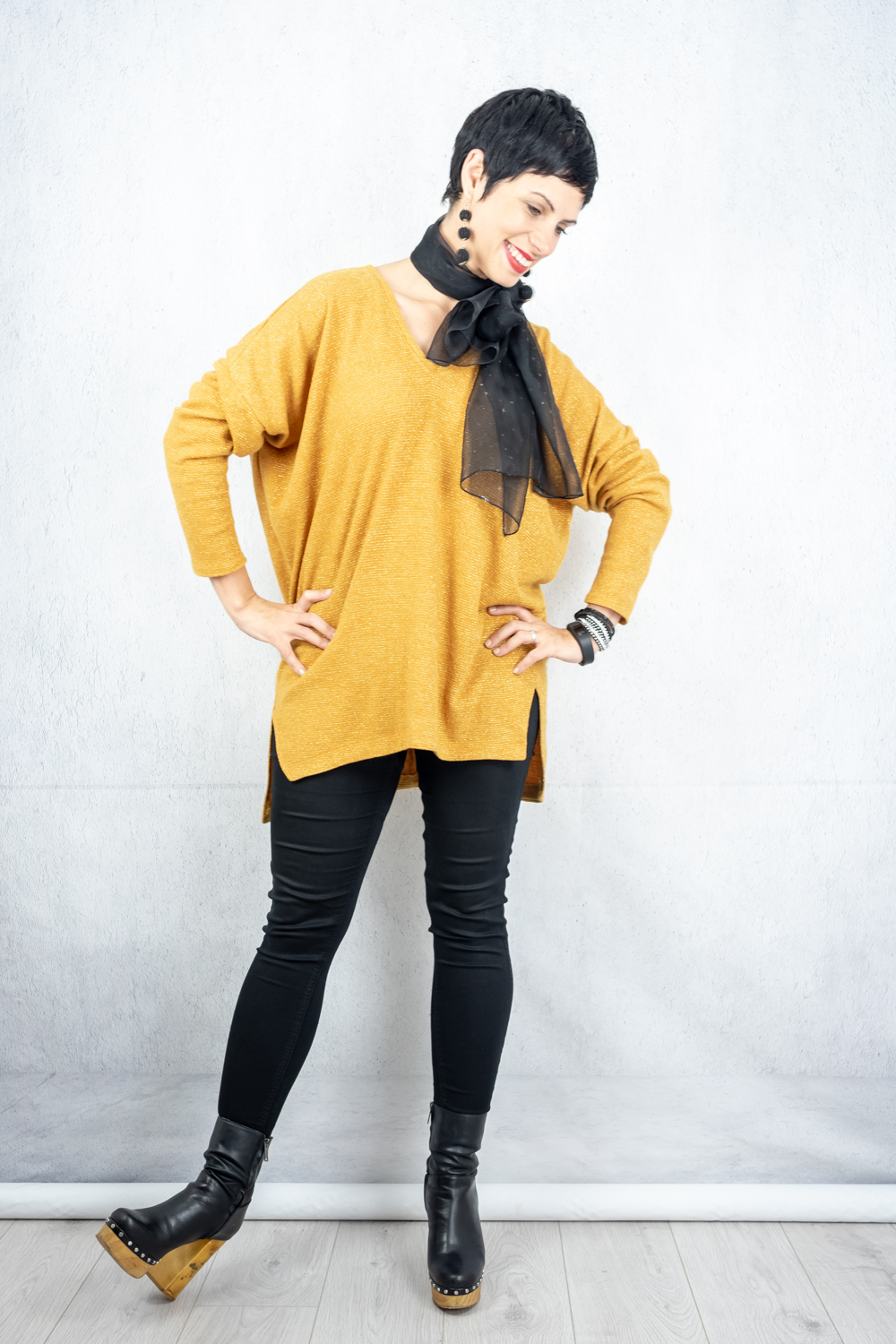 Oversized saffron jumper with metallic thread paired with skinny jeans, wooden platforms and a black scarf