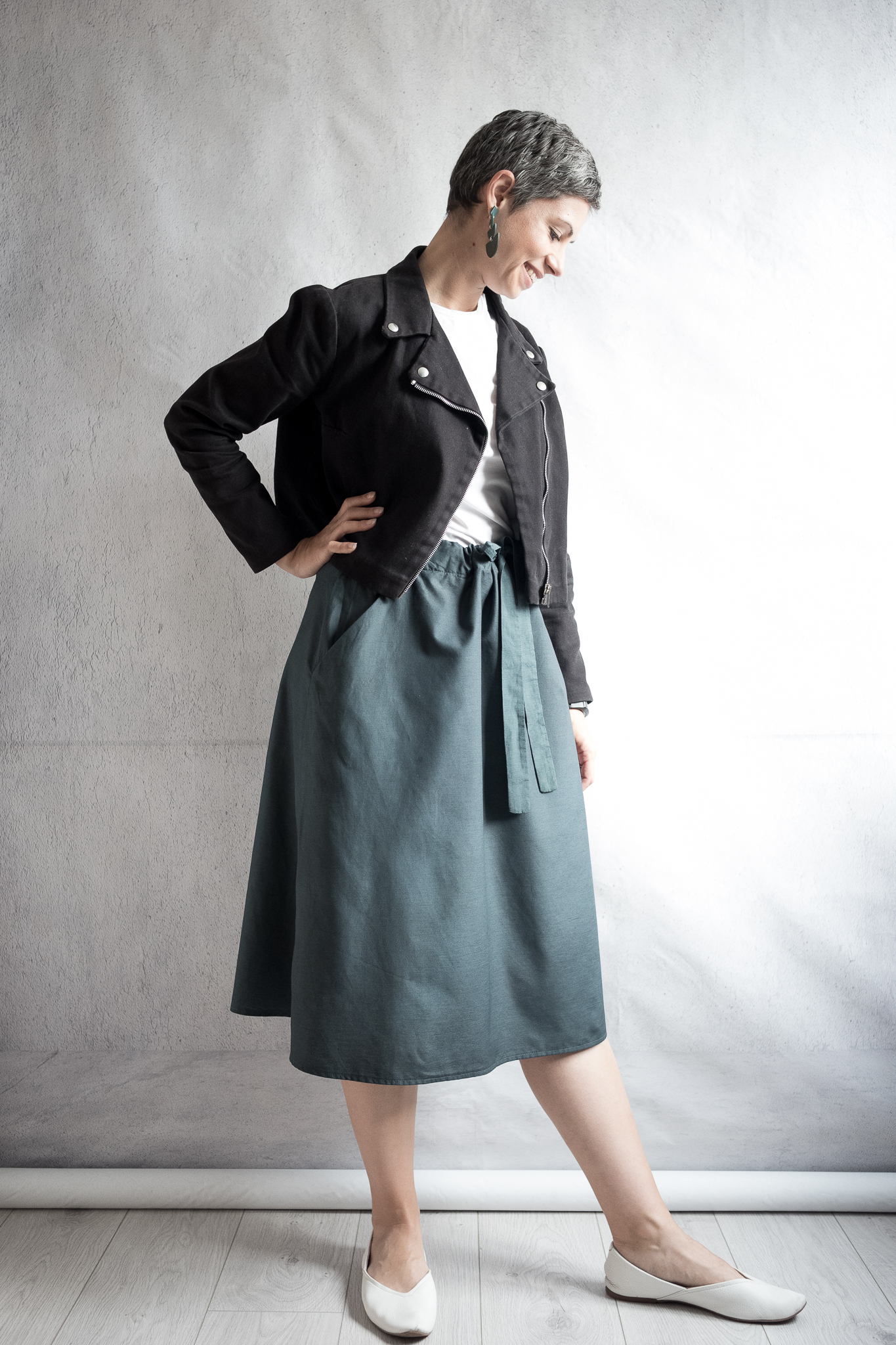 Outfit details: black denim cropped biker jacket, white fitted t-shirt, green A-line skirt with ties; white leather flats; polymer clay earrings.  Skirt made with Fibre Mood Jutta sewing pattern