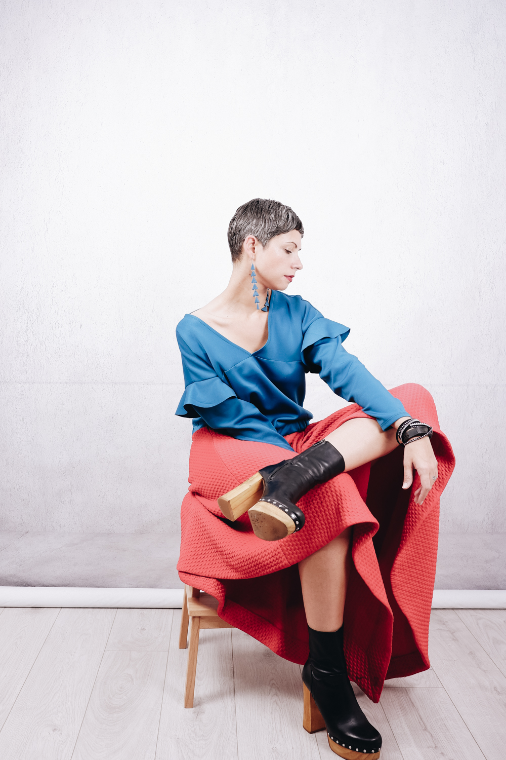 Outfit inspiration: DIY ruffle sleeve scuba sweater, paired with an asymmetric red skirt in textured scuba, wood block heel black leather boots and dangling teal polymer clay earrings. sewing | diy outfit | styling handmade items